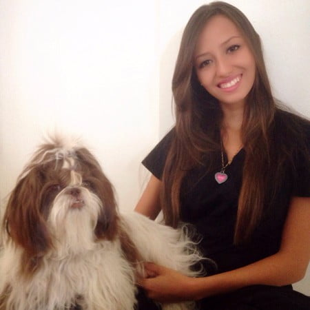 Team member Stephanie with a fluffy brown and white dog
